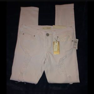 NWT Delia's Almost Famous white ripped jeans